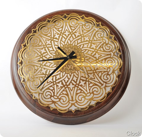Intricately-cut metal clock
