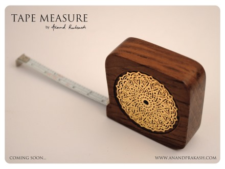 Tape measure in teak and metal by Anand Prakash